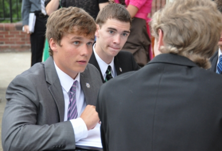 Madison, the blue party presidential candidate talking to a corporation executive