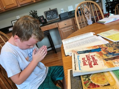 2018_9_26 - Carson, age 5, praying after Bible time.jpg